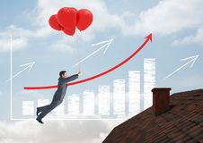 Incremented bar chart and Businessman floating with balloons by Roof with chimney and blue sky. Digital composite of Incremented bar chart and Businessman Royalty Free Stock Photography
