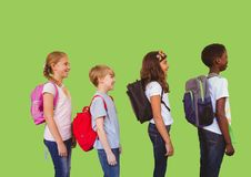 Kids with bags in front of green background. Digital composite of Kids with bags in front of green background Stock Images