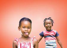 kids fooling around playing with blank orange background stock photos