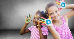 Kids with hands painted in grey room Stock Photography