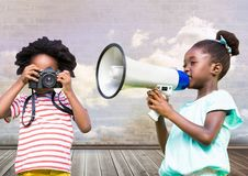 kids holding megaphone and camera with cloudy room background stock photos