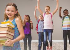 Kids jumping for joy in room with books Royalty Free Stock Photos