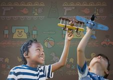 Kids playing with toy planes together with blank background and toy graphics Stock Images