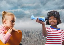 Kids with toy plane over city royalty free stock image