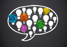 light bulbs chat bubble with crumpled paper balls in front of blackboard Royalty Free Stock Photos