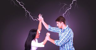Lightning strikes and abusive couple fighting. Digital composite of Lightning strikes and abusive couple fighting Royalty Free Stock Image