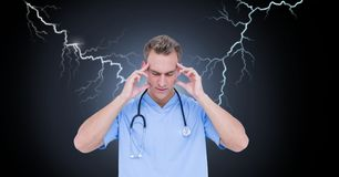Lightning strikes and stressed doctor nurse with headache holding head. Digital composite of Lightning strikes and stressed doctor nurse with headache holding Stock Photo