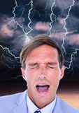 Lightning strikes and stressed man with headache holding head. Digital composite of Lightning strikes and stressed man with headache holding head royalty free stock image