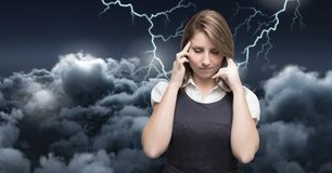 Lightning strikes and stressed woman with headache holding head. Digital composite of Lightning strikes and stressed woman with headache holding head Royalty Free Stock Image