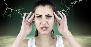 Lightning strikes and stressed woman with headache holding head. Digital composite of Lightning strikes and stressed woman with headache holding head Stock Image