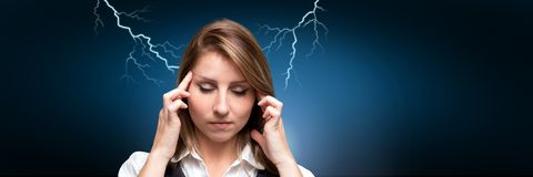 Lightning strikes and stressed woman with headache holding head. Digital composite of Lightning strikes and stressed woman with headache holding head Royalty Free Stock Images