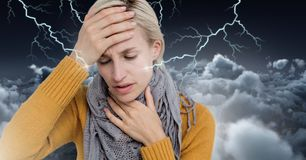 Lightning strikes and stressed woman with headache holding head. Digital composite of Lightning strikes and stressed woman with headache holding head Royalty Free Stock Photos