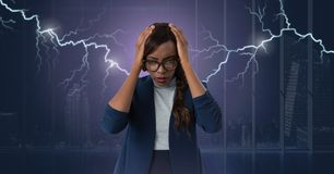 Lightning strikes and stressed woman with headache holding head. Digital composite of Lightning strikes and stressed woman with headache holding head Stock Photos