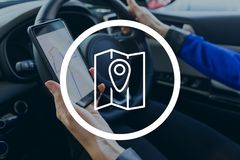 Location icon against person in the car Stock Photos