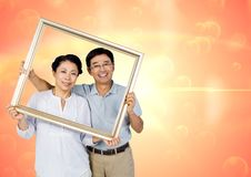 Digital composite of loving couple. On graphic background Royalty Free Stock Image