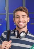 Male student with headphones in front of lockers. Digital composite of male student with headphones in front of lockers Stock Images