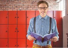 Male student holding book in front of lockers. Digital composite of male student holding book in front of lockers Royalty Free Stock Photography