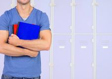 Male student holding books in front of lockers. Digital composite of male student holding books in front of lockers Stock Photography