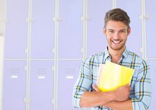 Male student holding files in front of lockers Stock Photography