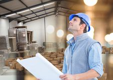 Man with box in warehouse, transition. Digital composite of man with box in warehouse, transition Royalty Free Stock Photo
