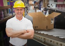 Man with boxes on conveyor belt in warehouse Stock Photography