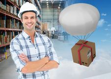 man with boxes in warehouse, transition Stock Image