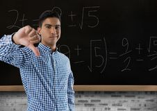 Man in classroom thumbs down royalty free stock photo