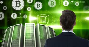 Man with computer servers and bitcoin technology information interface. Digital composite of Man with computer servers and bitcoin technology information stock photo