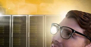 Man with computer servers and glasses. Digital composite of Man with computer servers and glasses Royalty Free Stock Photography
