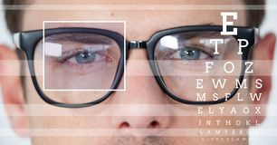 man with eye focus box detail over glasses and lines and Eye test interface royalty free stock photography
