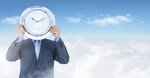 Man holding clock in front of sky Royalty Free Stock Photos