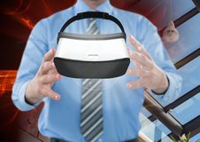 Man holding and interacting with virtual reality headset with transition effect Royalty Free Stock Image