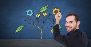 Man holding pen and Drawing of Business graphics on plant branches on wall Stock Photos