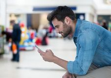 Man holding phone in mall shopping center Royalty Free Stock Images