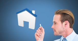 Man holding wire connection with home icon. Digital composite of Man holding wire connection with home icon Stock Images