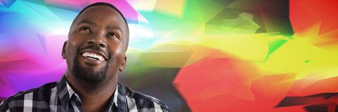 Man looking up with colorful background. Digital composite of Man looking up with colorful background Stock Photography