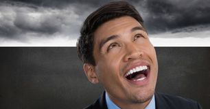 Man looking up and laughing with grey background. Digital composite of Man looking up and laughing with grey background Stock Images