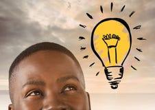 Man looking up at light bulb idea. Digital composite of man looking up at light bulb idea Royalty Free Stock Photo