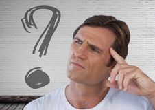Man looking up at question mark. Digital composite of man looking up at question mark Stock Images