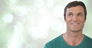 Man looking up with sparkling green background. Digital composite of Man looking up with sparkling green background Stock Photos
