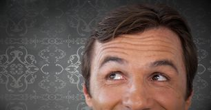 Man looking up with wallpaper pattern background. Digital composite of Man looking up with wallpaper pattern background Stock Images