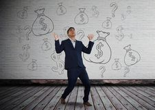 Man screeming in front of money on wall Stock Photo