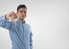 man in shirt with thumbs down stock photography