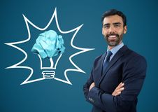 Man standing next to light bulb with crumpled paper ball Royalty Free Stock Photos