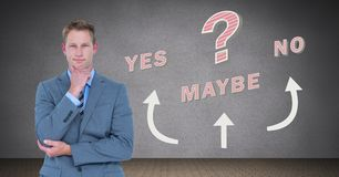 Man thinking Yes No Maybe text with arrows graphic on wall. Digital composite of Man thinking Yes No Maybe text with arrows graphic on wall Stock Photos