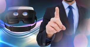 Man touching and interacting with virtual reality headset with transition effect. Digital composite of Man touching and interacting with virtual reality headset Royalty Free Stock Image