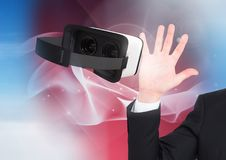 Man touching and interacting with virtual reality headset with transition effect Stock Photography