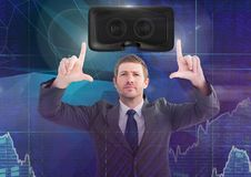 Man touching and interacting with virtual reality headset with transition effect. Digital composite of Man touching and interacting with virtual reality headset Royalty Free Stock Photos