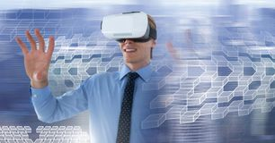 Man wearing virtual reality headset with geometric transition. Digital composite of Man wearing virtual reality headset with geometric transition Royalty Free Stock Photography