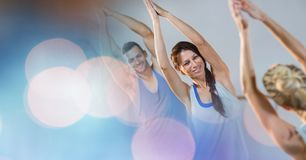 Man and women performing yoga royalty free stock images